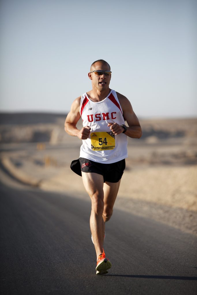 A marine running, in the desert of the mojave. Burn fat and Oorah!