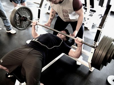 An image of a guy bench pressing